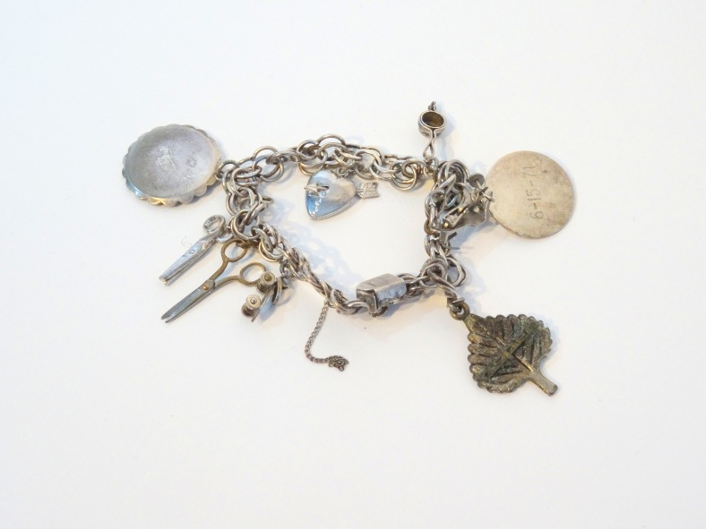 Lee Franclemont's charm bracelet, which charms from 1940s and beyond. Photo credit Kelise Franclemont.